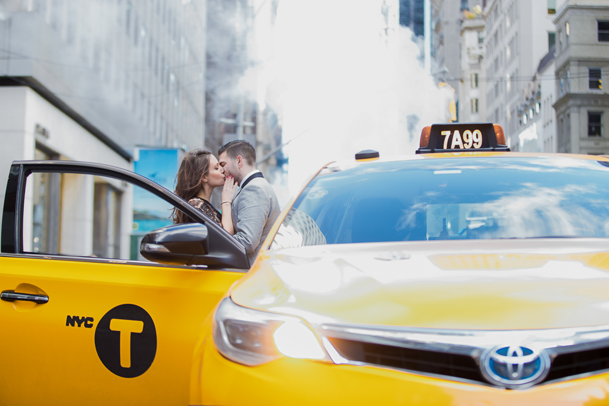 NYC Wedding Photographer yellow taxi cab engagement photos