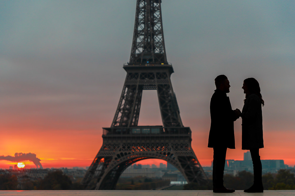 Paris surprise proposal at the Eiffel Tower during sunrise