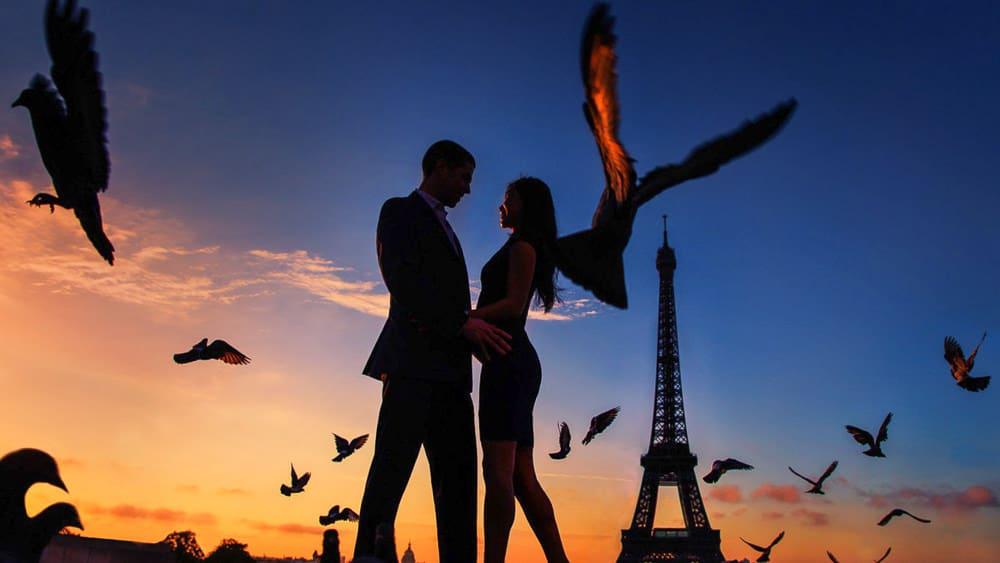 Sunrise silhouette Paris engagement photographer Eiffel Tower pigeons photo