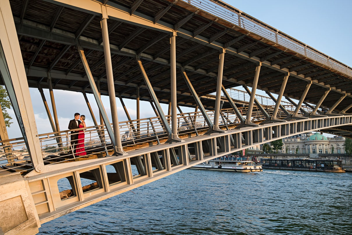 Paris photographer paris engagement photos Seine River bridge