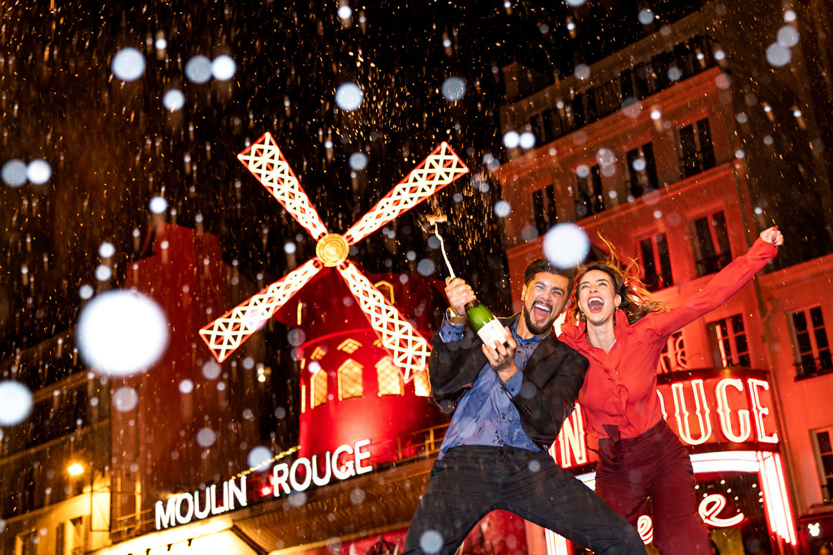 Best Paris photographer Moulin Rouge Paris engagement photo session
