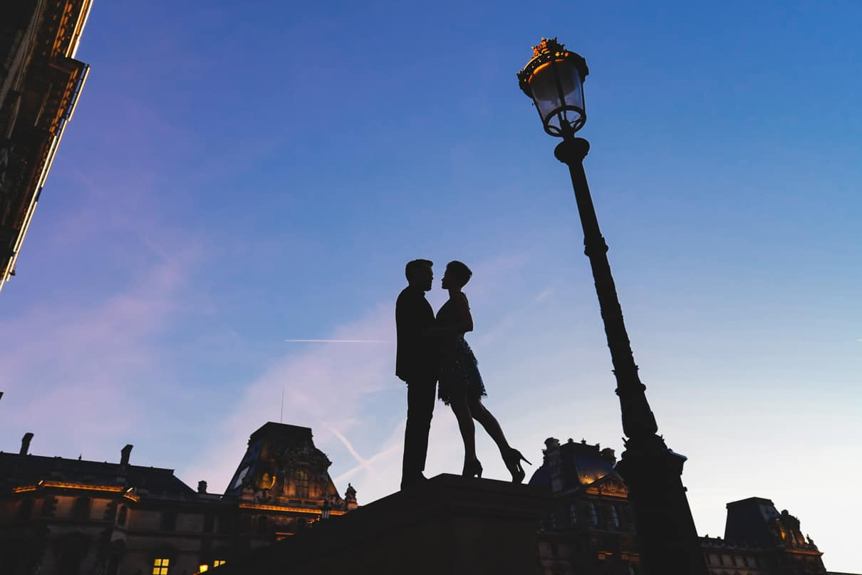 Paris engagement photos at the Louvre Museum during the Blue Hour