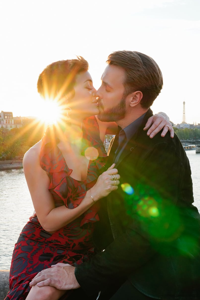 Romantic Paris engagement photos along the Seine River by Notre Dame
